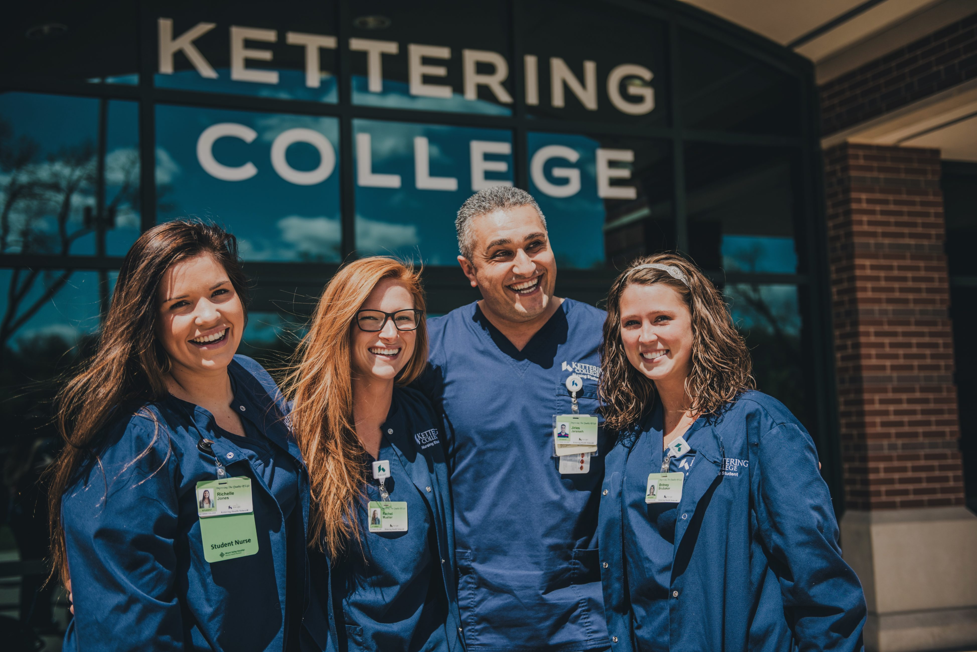 nursing students in their blue scrubs in front of Kettering College