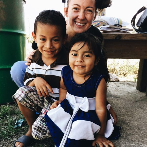 Emily, an occupational therapy student from Kettering College, poses with two children from Belize during last years mission trip.