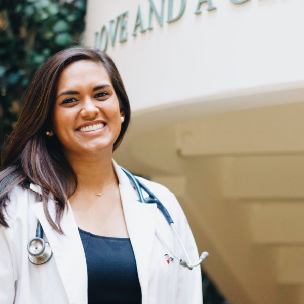Physician Assistant student posing in her white coat